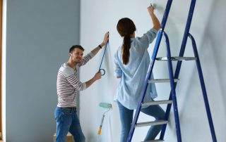 Portrait,Of,Happy,Smiling,Young,Couple,Painting,Interior,Wall,New