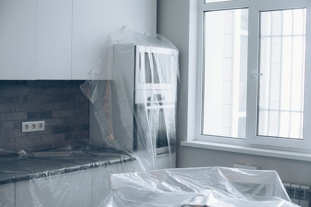 Furniture covered with plastic on the kitchen for window installation