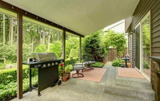 Covered,Walkout,Deck,With,Patio,Area,And,Landscape