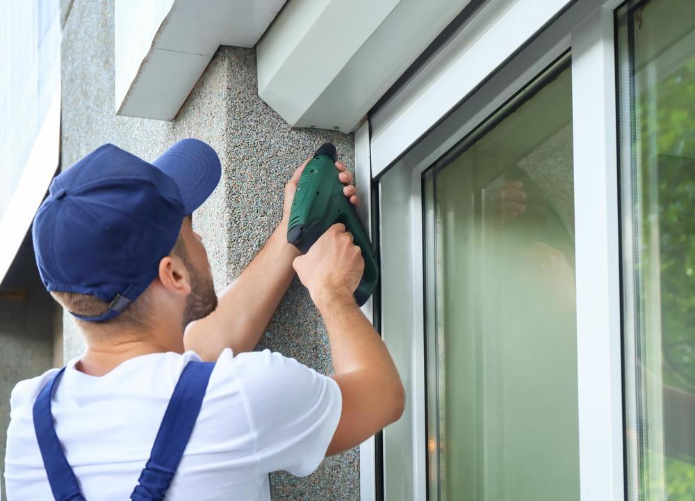 Man installing a window (How Do I Find a Good Window Installer)